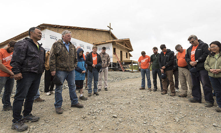 Samaritan's Purse President Franklin Graham is praying with construction volunteers and also with church members and residents of Togiak, Alaska.