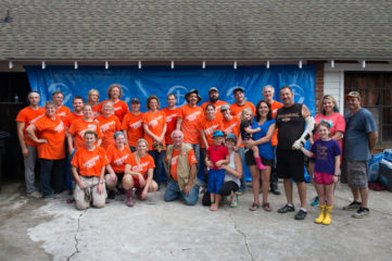 A large group of Samaritan's Purse volunteers worked on the home of injured police officer Bruce Simmons.