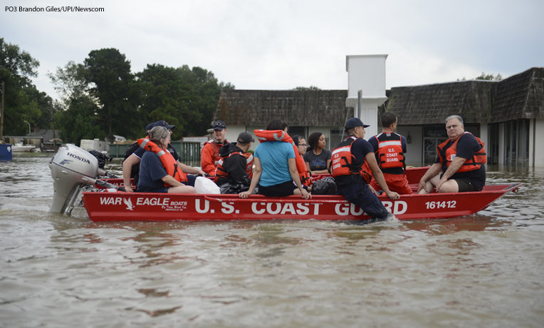 The U.S. Coast Guard helps residents escape their flooded homes in Baton Rouge, Louisiana.