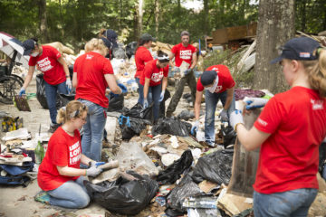 Volunteers sort through Elizabeth's belongings