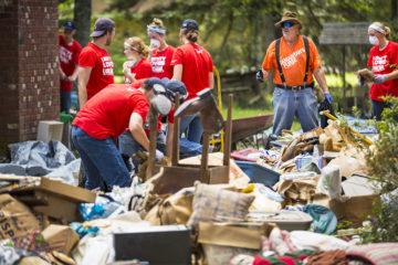 Samaritan's Purse volunteers sort through Elizabeth's belongings.