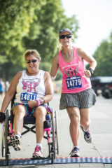 Hemiplegic stroke survivor Vicky Wallace completed the race with one leg and the help of Melissa Peplow.