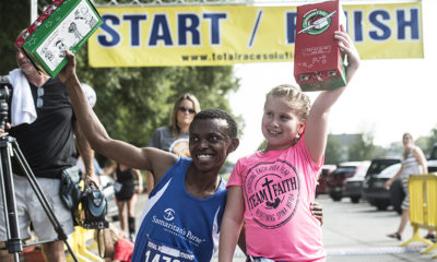 Shoebox recipient Alex Nsengimana and Faith Russell celebrate after completing the Team Faith 5K for Operation Christmas Child.