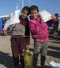 Monthly food rations are critical for displaced families.