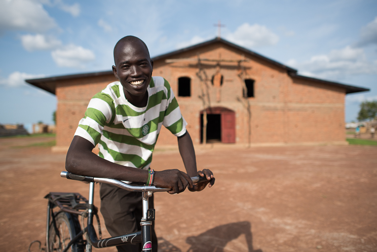 Philip Alich Mayoldit pedals his bicycle throughout Aweil—and beyond—to proclaim the Gospel.