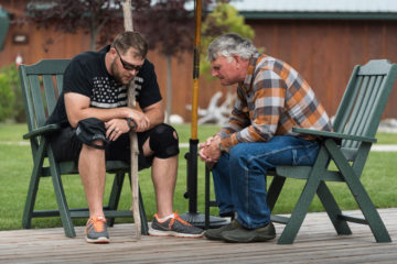 Michael Ossner prays with Franklin Graham to receive Christ during Week 8 of Operation Heal Our Patriots at Samaritan Lodge Alaska