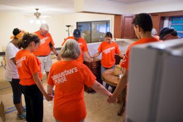 Our volunteer teams begin their day in prayer.