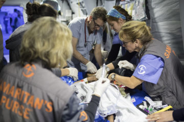 Medical personnel are caring for patients with severe injuries at our field hospital.