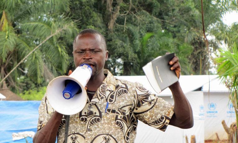 A Samaritan's Purse staff member shares the Word of God at Doruma Camp