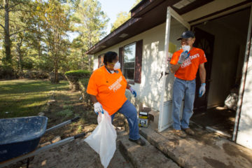 Hurricane Matthew North Carolina: Sue Bynum was both a beneficiary and volunteer in Pinetops. Volunteer Mike Klein of Raleigh stands at right.