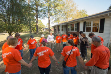 North Carolina Hurricane Matthew: Volunteers gathered to pray as they worked on the home of deacon James Horne.