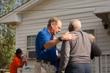 Chaplain Dave Barlow prays with James.