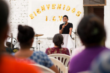 Luis speaks at his home church