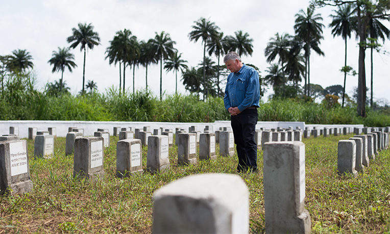 Franklin Graham pauses to pray at the Ebola Memorial Cemetery in Foya, Liberia.