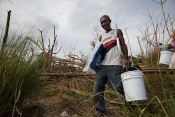 Man in Les Cayes with emergency relief supplies