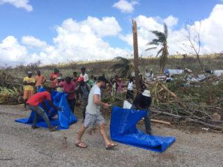 Distributing tarps in Haiti
