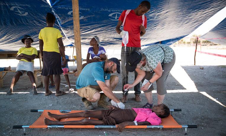 Treating a woman at the cholera clinic