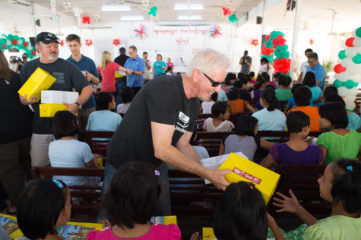 John Barbour of The Tommy Coomes Band hands out shoebox gifts in Myanmar.