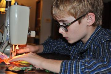 Isaac sewing