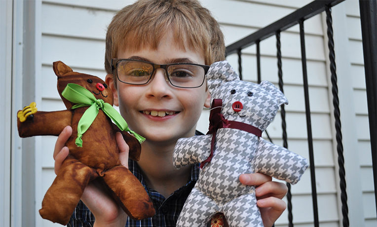 Isaac DeHaven and his teddy bears