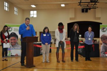 Dr. David Piccolo (at podium) leads the group in prayer. (left to right) Jenny Hartzog, Katrina Houston, Sue Cuthbert, and Linda Rhyne also prayed. Izabella McMillon is at left in the background.