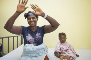 Martha praises God after her grandson Augustine's successful surgery.