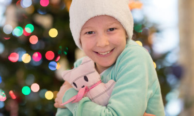 Emma Hemphill hugs a sample of the donated homemade teddy bears she packed in her Operation Christmas Child shoeboxes.