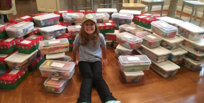 "Emma celebrates packing 110 shoeboxes! ""We are praying that every child who receives a box will come to know Jesus,"" her mom, Maegan, said."