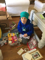 Emma enjoys packing some of her shoebox gifts at home.