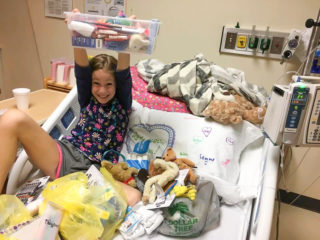 Emma packs shoebox gifts from her hospital room on the oncology floor.