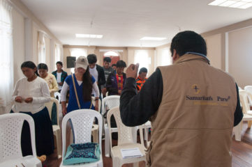David Cachi leads the group of young evangelists in a prayer for their Chuma communities.