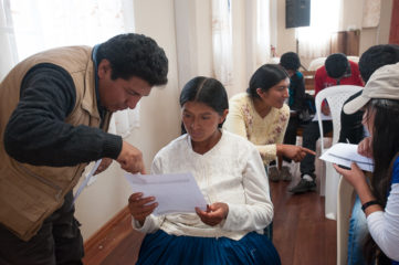 David Cachi works with Arminda, 28, during one of the discipleship group's in-person meetings.