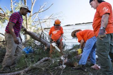 Volunteers work on a property in Hattiesburg.