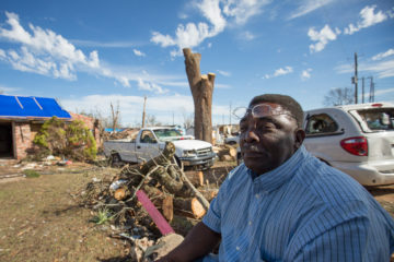Nathaniel Hibbler's home was shaded by a massive tree before its iron-bending limbs crashed in between his and his son's homes.