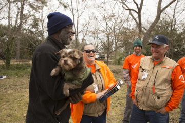 Jerry Stamper and his dog Captain with volunteers who presented him a new Bible. Jerry was among those saved during the Albany response.