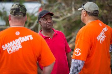 Homeowner Benny Pritchett speaks with Samaritan's Purse volunteers.