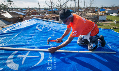 Tarping a roof after a tornado ripped through New Orleans East.