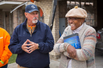 Greg's wife Janet holds the new Bible presented to the couple by Samaritan's Purse.