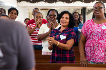 During a training, teachers learn a new Gospel song that they can teach to children.