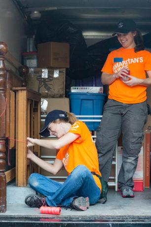1728US-C: students moving furniture at Leah Calmes home in Denham Springs, LA