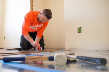 Drew Toothman worked hard on the home of James and Arbutus Sams. Drew on the floor working in West Virginia home flooded last year.