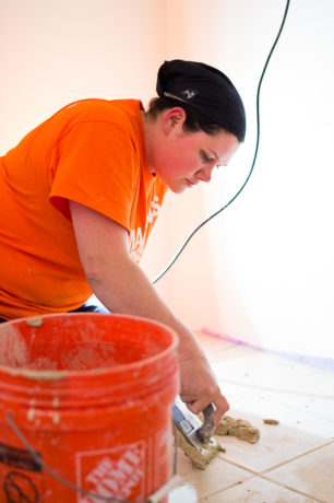 Misty Toothman and her husband Drew, a retired Marine, worked hard in West Virginia on our rebuild project.  Photo of her doing tiling work.