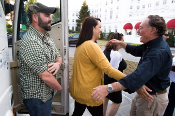 Josh and Amber McCart greet Chaplain Jim Fisher on arrival at the Greenbrier.