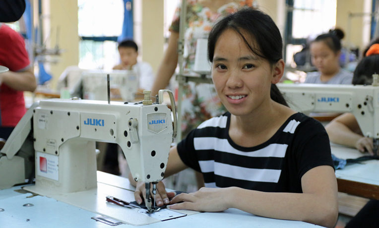Vietnamese woman attends vocational school to learn sewing and embroidery.