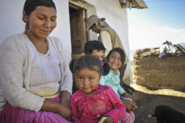 Margarita with her daughters in Bolivia.