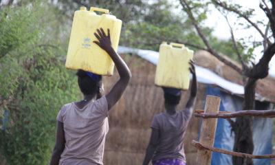 Women bringing water back to their families.