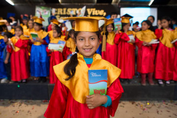 Paola was proud to receive her own New Testament at her graduation from The Greatest Journey.