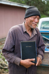 Homeowner David Bailey was excited to receive a Bible from Samaritan's Purse volunteers on the day—May 10—that he accepted Jesus as Savior.