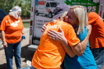 Gail Keck hugs a volunteer goodbye in thanks for lifting the burden off her and her husband to gut their flooded home themselves.