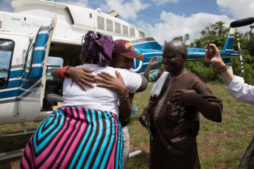 Sampson hugs the grandmother who raised him. A Samaritan's Purse helicopter carried him on the last leg of his journey.